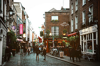 Temple bar in Dublin with people on the street